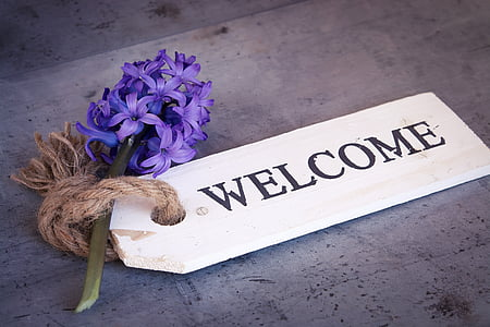 purple hyacinth and white wooden welcome tag