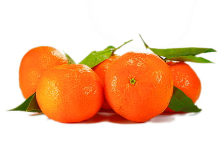 five orange fruits with white as background