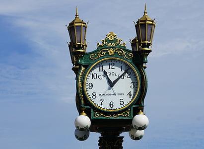 green clock tower at 11:07