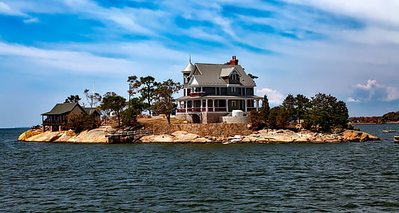 landscape photography of island with white and gray house during daytime