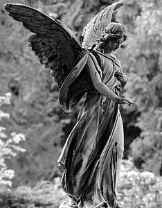 closeup photo of angle statue