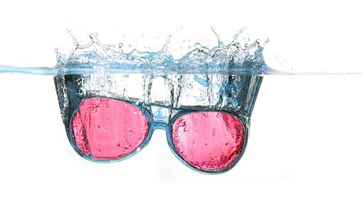 black framed red lens sunglasses in water