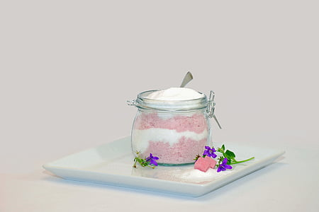clear glass jar with cream