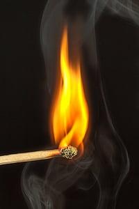 burning brown matchstick