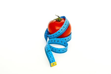 blue tape measure and red tomato