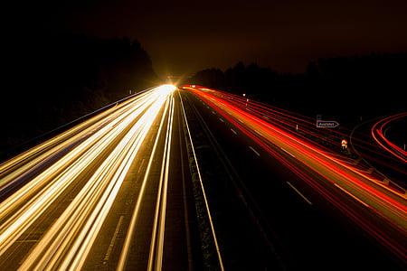 timelapse photo of cars on black asphalt road