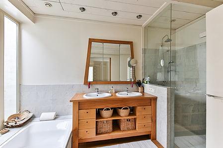 brown wooden bathroom rack and sink