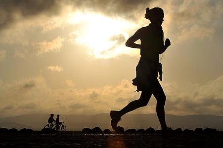 silhouette photo of person jogging