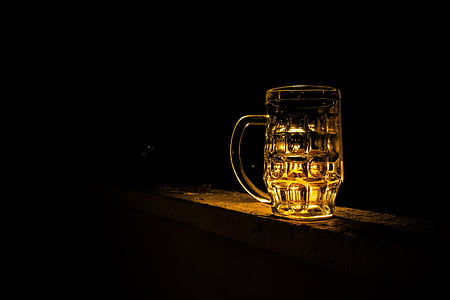 clear glass mug with brown light