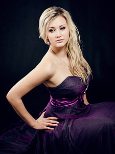 woman wearing purple dress