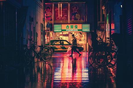woman walking on pathway during nighttime