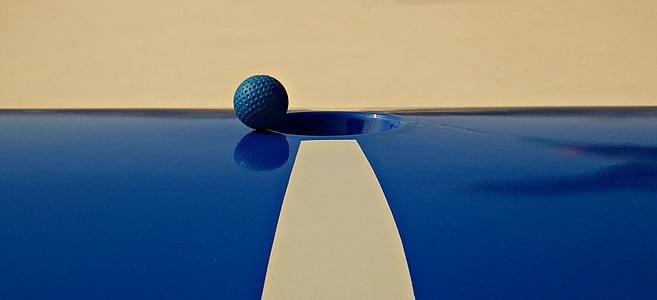 blue ball near hole
