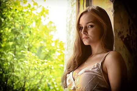 woman wearing beige spaghetti-strap top