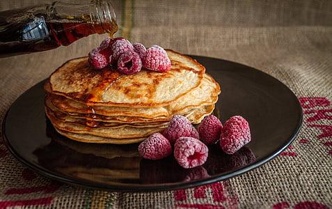 pancake on round black ceramic plate