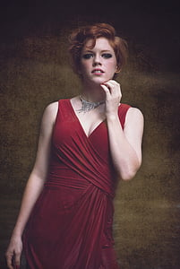 woman in red sleeveless dress painting