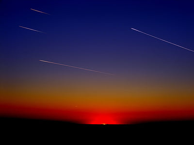 shooting stars photo during sunset