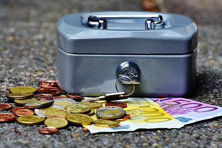 stainless steel security box with coins and banknotes