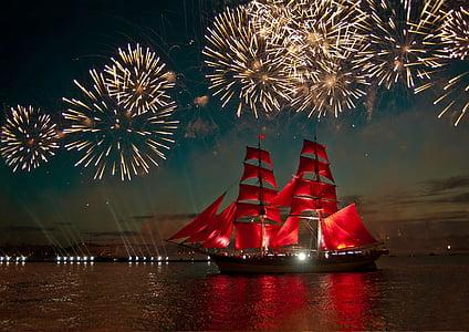 red and beige ship under fireworks landscape photograph