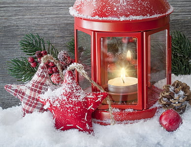 red tealight candle holder on snow flakes