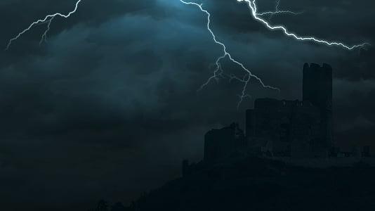 silhouette of buildings during thunder