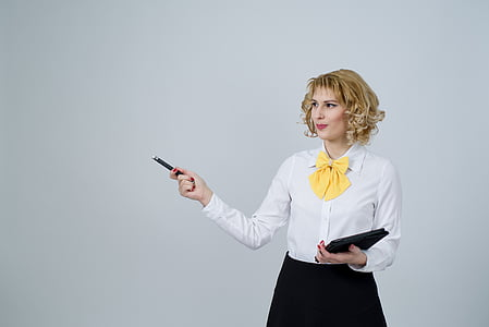 woman in white long-sleeved blouse holding laser pen