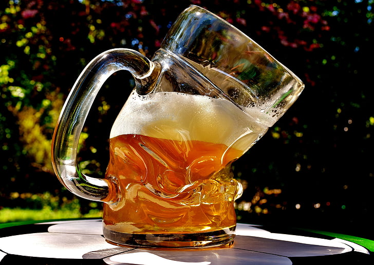 clear glass beer mug filled with beer