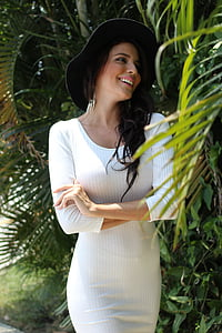 woman wearing white long-sleeve dress and black hat
