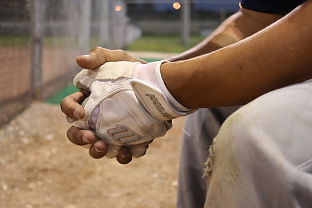 closeup photo of a person wearing white fingerless glove