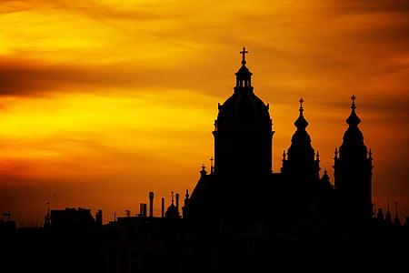 silhoutte of castle under orange sky