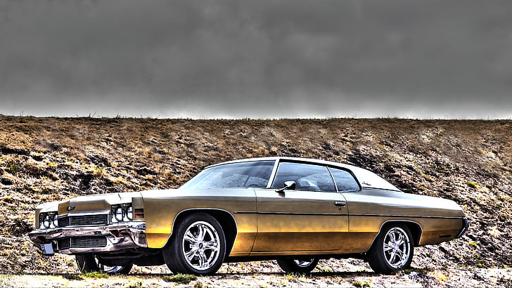gold-colored coupe