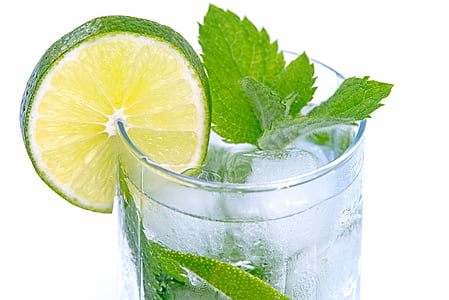 green leaf and sliced lime on clear glass drinking cup