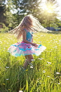 girl wearing dress in grass field