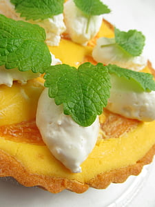 yellow pastries and green mint leaves