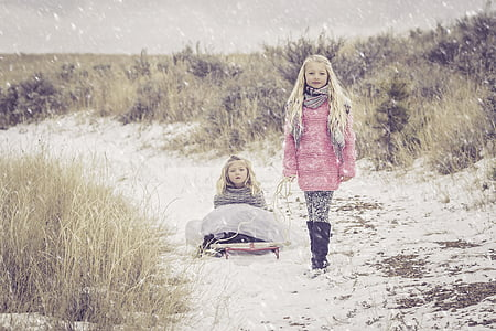 two girls wearing pink and gray sweats during winter