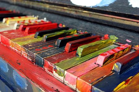 close photo of assorted-color piano keys