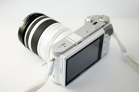 white and black point-and-shoot camera