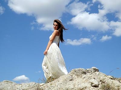 woman wearing white sleeveless dress