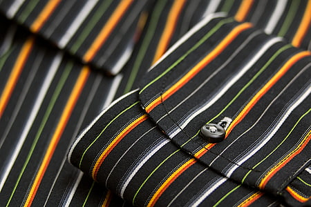 folded white and black striped textile
