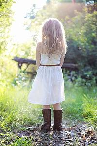 girl wearing white strapless dress