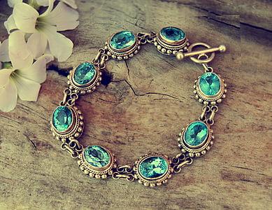 gold-colored blue gemstone encrusted bracelet