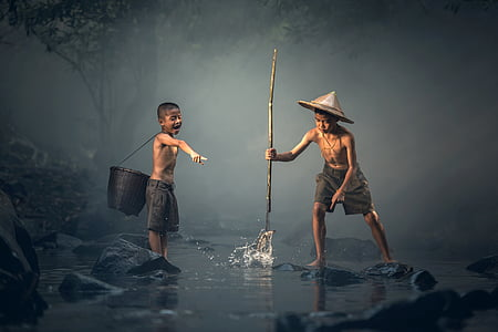 two boy playing on water