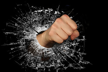 hand punching on glass