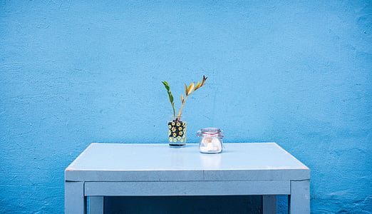 glass mason jar placed on rectangular white wooden desk