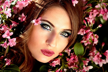 woman in pink lips surrounded with pink flowers