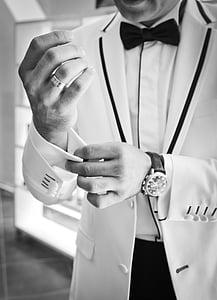 man in white tuxedo