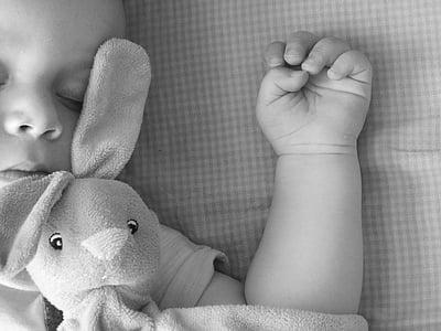 baby sleeping grayscale photo