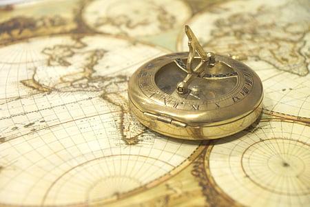 gray steel compass on map closeup phot