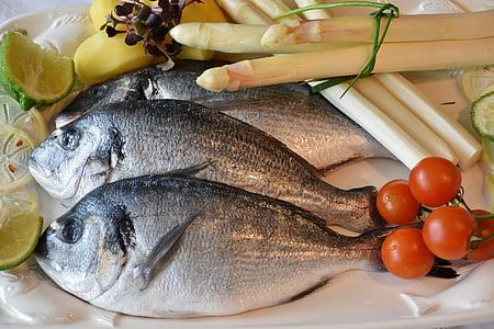 three gray fish on white plate
