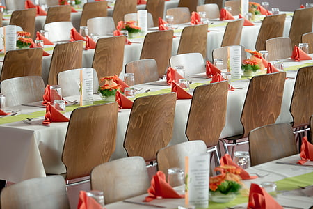 brown wooden chairs in front of table