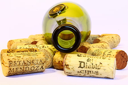 green wine bottle with assorted wine corks